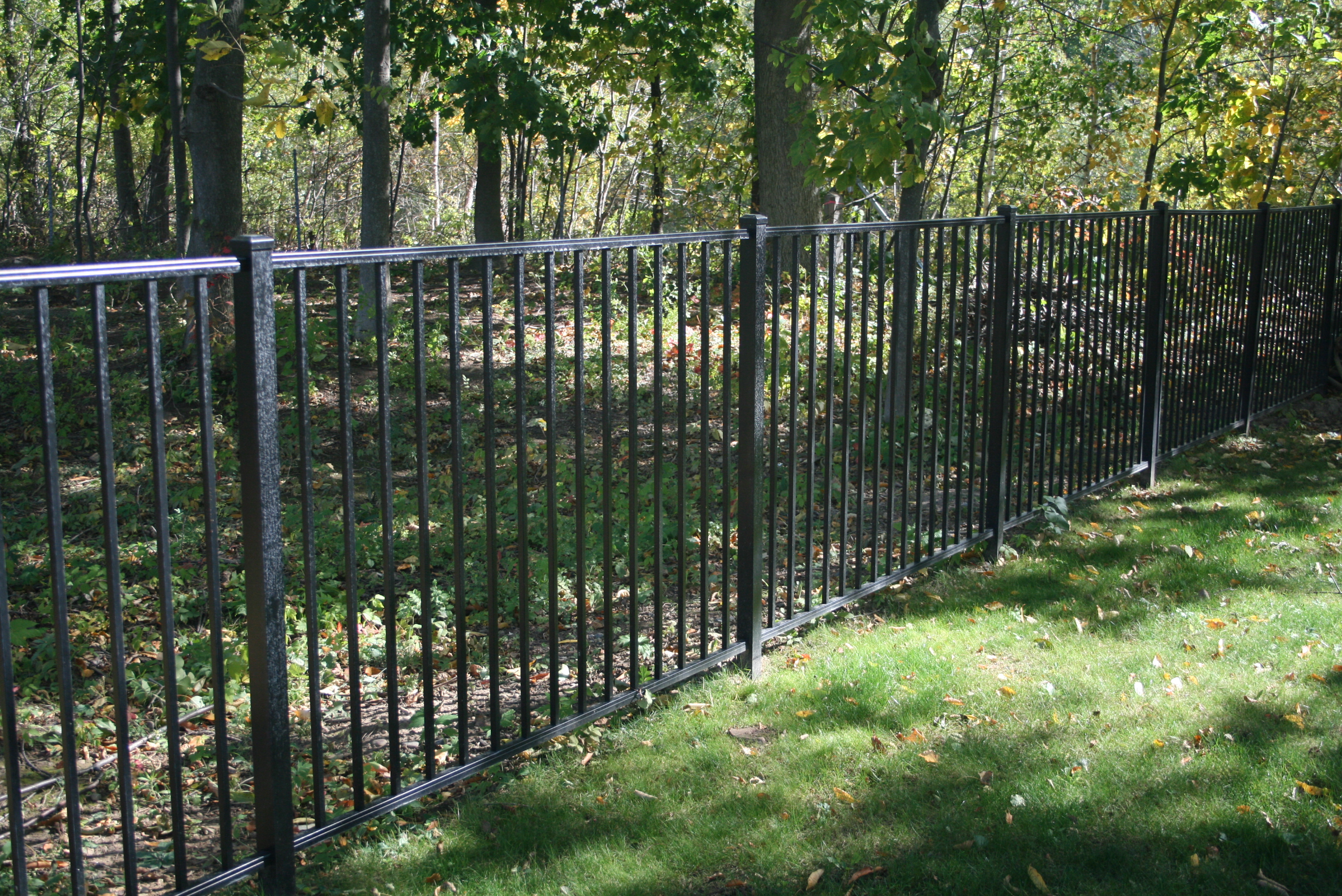 New Black Fence installation to surround pool area - Gasparini Fence Company near Syracuse NY